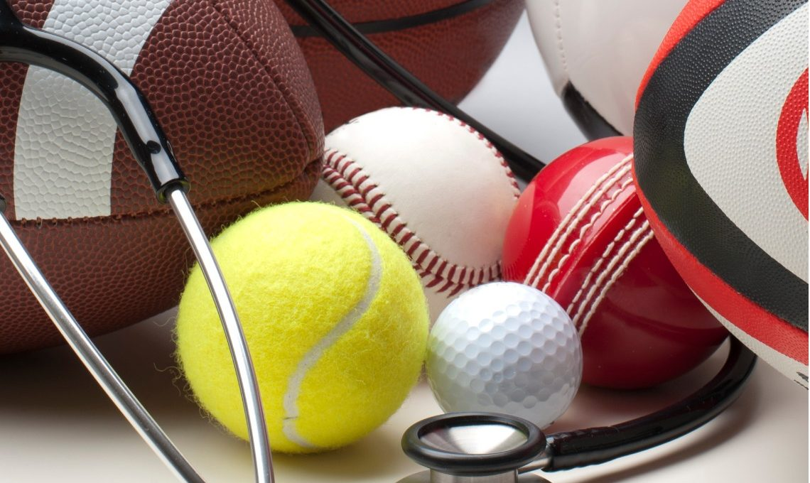 Different sports balls with stethoscope