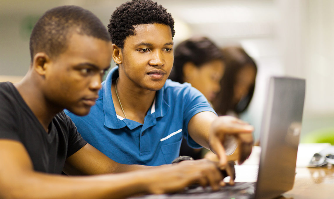 Young African men using laptop to learn online