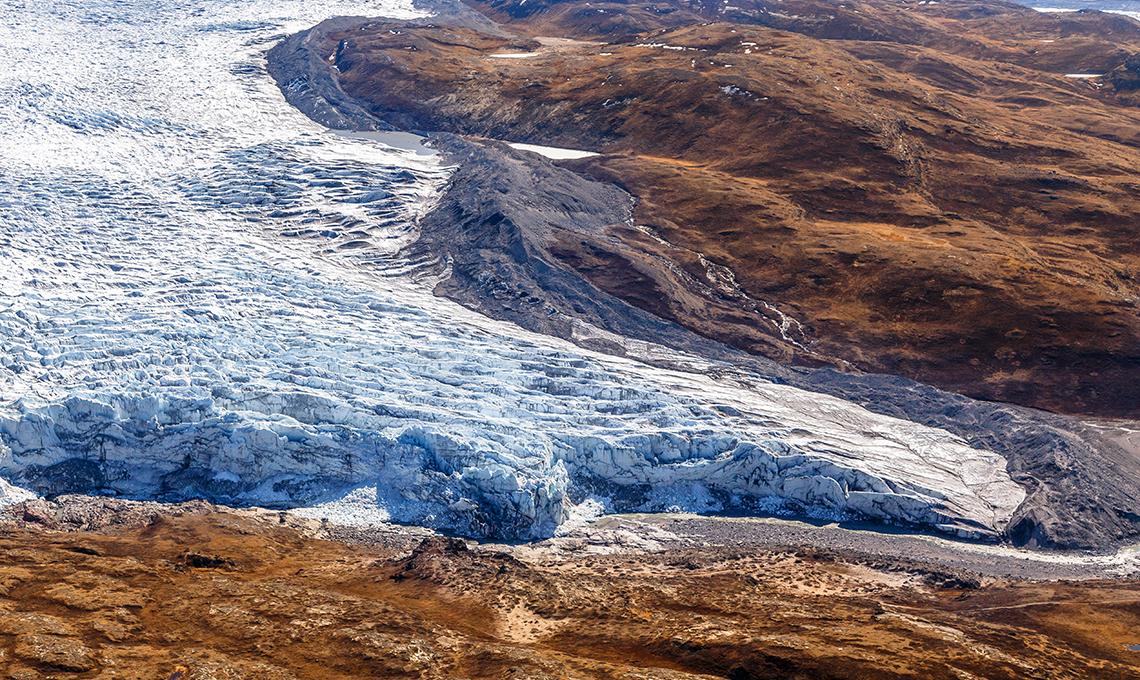 Greenlandic ice cap melting glacier with tundra aerial view, near Kangerlussuaq, Greenland